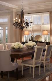 A beautiful dining room - restain table, new chairs, light fixture, neutral  carpet.