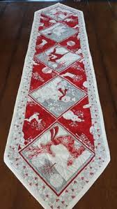 Valentine's Day and St Patrick's Day Table Runner by Covequilter ... & ... use those special borders and specialty prints or whatever they're  called, eh Jordan? Red White and Silver Christmas Table Runners by  SerenaBeanQuilts Adamdwight.com
