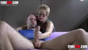 Mother helping his son with masturbation