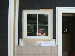 vinyl siding around windows with built in j channel