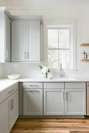 dove gray shaker cabinets with wooden shelving