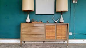 this is an awesome mid century piece there are three large drawers and two sliding doors to open up to storage and small white drawers