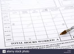 total hours worked on a weekly timesheet for a temping employment stock photo total hours worked on a weekly timesheet for a temping employment agency