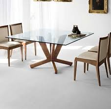 Glass top dining tables Wood Wood Base And Glass Top For Square Table Homedit 40 Glass Dining Room Tables To Revamp With From Rectangle To Square
