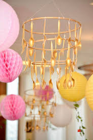 gold flatware chandelier from a beauty and the beast birthday party on kara s party ideas