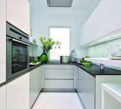 Small And Narrow White Kitchen Design Idea With Under Wall Cabinet Lighting  And Black Granite Countertop Also Electric Cooktop