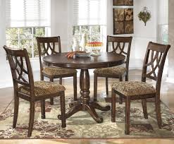 Leahlyn 5 Piece Cherry Finish Round Dining Table Set By Ashley Signature Design At Dunk Bright Furniture
