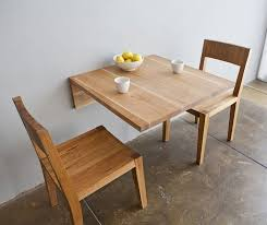 the wall mounted table is basically a slab of wood that you can attach to your wall throw some chairs around it and call it a table and is a modern and