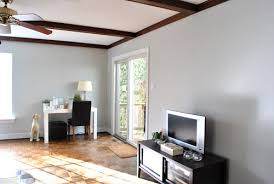 paint colors with dark wood trimHuzzah We Painted The Wood Trim In Our Living Room  Voc paint