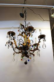 six arm wheat sheaf chandelier with multi colored glass drops