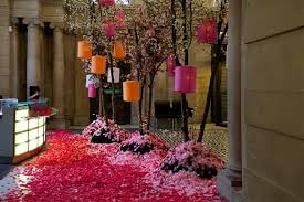 The oriental theme carried over into the decorations with Pink Blossom  scattered around the event