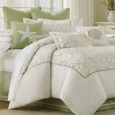 white bedding sets with green pillows and white bed on