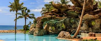 infinity pool united states. A Rocky, Ocean-themed Outcropping And Several Palm Trees Surround The Ka Maka Grotto Infinity Pool United States