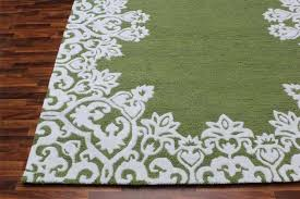 green and white area rug mint