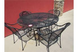 48 round wrought iron and expanded metal patio table and 4 chairs w umbrella