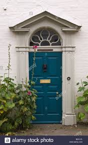 blue front doorBlue front door of classical design with triangular pediment and