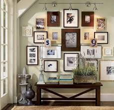 wall art hanging in a gallery style on wall art gallery ideas with wall art ideas create a gallery decorating envy