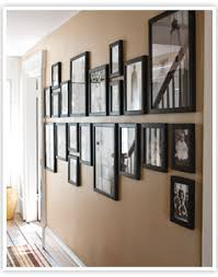 Mark a horizontal line and hang picture frames or your childrens' art work  on either side of the line.perfect for a back hallway