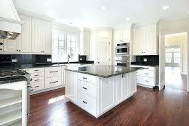 gray granite countertops with white cabinets contemporary