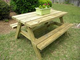 simple outdoor wooden picnic table with benches built in made from reclaimed wood ideas