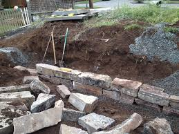 how to build a dry stack stone retaining wall fasoldt gardens