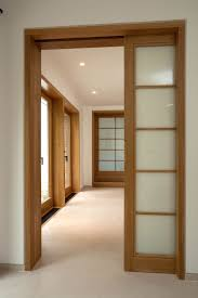 excellent interior design with wooden frames window and wooden pocket doors also glass panel combined