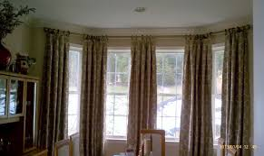Inverted pleated panels work beautifully in a bay window