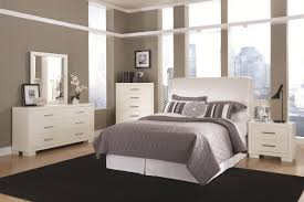 bedroom furniture oversized teak dark brown rectangle bookshelves recessed lighting carpet solid wood wingback gothic bookcase woman king bed white king