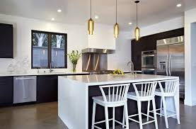 glass kitchen hanging lights over white kitchen island with seating