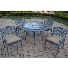oakland living mississippi 5 piece cast aluminum patio dining set with 48 round table and 4 cushioned arm chairs in verdi grey