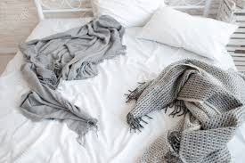 unmade bed side view. Stock Photo - Unmade Messy Bed With Wrinkled Sheets And Blankets. Top View On In The Morning After Awakening. White Pillows Gray Side 0