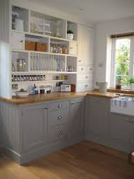 black cabinet pulls on gray cabinets. light coloured kitchen cabinets with stainless steel cup drawer pulls below airtight glass jars beside retro black cabinet on gray