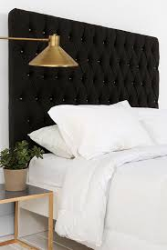 Brass Sconce + Button Headboard via Urban Outfitters. I also have a black  button head board - I'm really loving how it looks with the brass lamp next  to it.