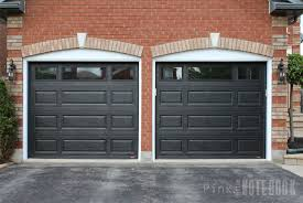 although the black garage is a deep contrast against our red brick i will show you in uping posts how i will pull together a cohesive look
