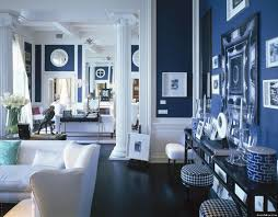 If you are ready to commit to navy blue. This living space does a great job  of layering navy blue walls with navy accessories and furniture.