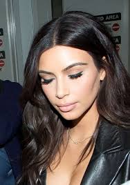 kim kardashian showed off an impeccably done cat eye as she arrived on a flight at