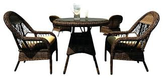 wicker outdoor dining sets 3 piece round wicker patio dining set canvas wheat cushions traditional outdoor