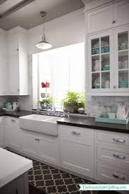 Garden Windows For Kitchens White Cabinets Black Counter Marble Backsplash And An