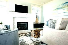 living room with tv and fireplace living room with fireplace and on opposite walls living room living room with tv and fireplace