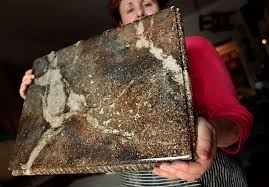 kay mount shows a sample of a faux stone countertop at her studio in chesapeake