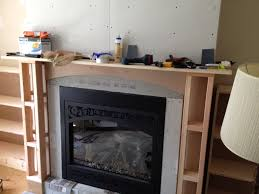 gas fireplace counterpoint framing continued with the mantle hearth and wood shelves on each side i