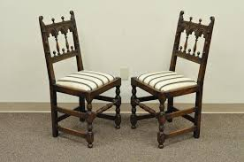 quality set of eight vine solid carved oak jacobean or gothic style dining chairs circa