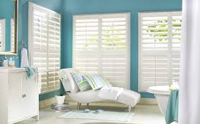 decorating white plantation blinds with modern lounge chair also blue paint wall for living room perfect custom plantation shutters calculator vinyl
