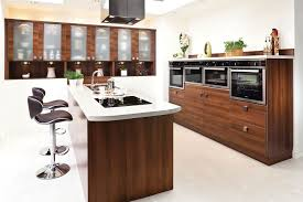 Laminate Wood Flooring Kitchen Blue Stained Wall And Vase Flowe Kitchens Island Sinks Seating