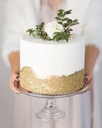 Picture Of A Modern Wedding Cake With Gold Glitter And Fresh
