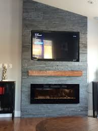 Grey stone fireplace with floating mantle electric fireplace