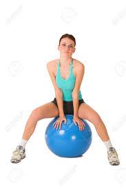 stock photo woman sitting on gym ball