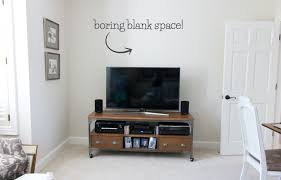 Pic of blank space above the TV before we decorated it! Click over for the