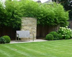 Small Picture modern garden design ideas sone wall bamboo fence panels bench
