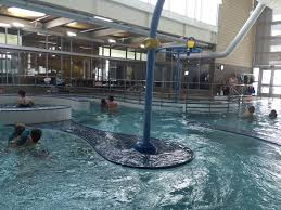 indoor pool and hot tub with a slide. The Rainier Beach Community Center Pool Is Really Two Indoor Pools: A Lap And Hot Tub With Slide